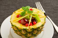 pineapple stuffed with fruits - stock photo