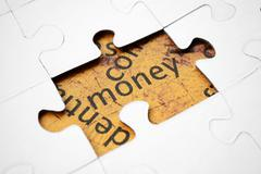 money puzzle - stock photo