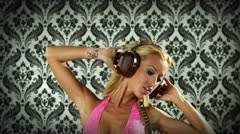 Blonde girl dancing music retro headphones Stock Footage