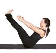 yoga excercising navasana - stock photo