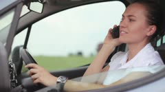 Young businesswoman in the car using cell phone and looking at her watch HD Stock Footage
