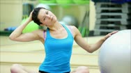 Beautiful girl does exercises with the ball at the gym 11 Stock Footage