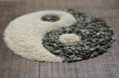 a yin-yang made from seeds - stock photo