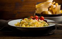 Pasta with cheese and rosemary Stock Photos