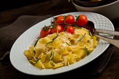 pasta with cheese and rosemary - stock photo