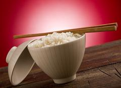 Stock Photo of rice with asian chopstick