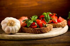 Stock Photo of bruschetta appetizer with fresh tomatoes
