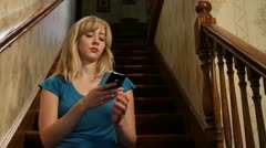 Woman texting then talks on iPhone - stock footage