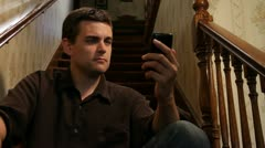 Man texting & then talking on iPhone - stock footage