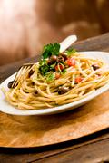 pasta with olives and parsley - stock photo