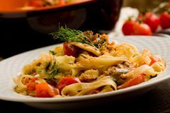 pasta with sardines - stock photo