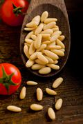 Pine nuts on wooden spoon Stock Photos