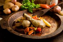 stewed chicken with vegetables - stock photo
