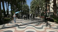 People on the promenade of Alicante, Spain Stock Footage