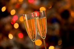 champagner on glass table with bokeh background - stock photo