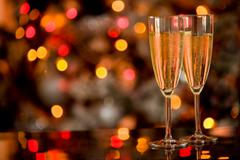 Champagner on glass table with bokeh background Stock Photos