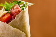 Stock Photo of tortillas with bacon and arugula salad