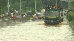 Aid Trucks Drive Through Flooded Road In Manila Philippines Stock Footage
