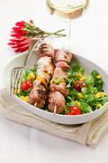 meat skewers on white table - stock photo