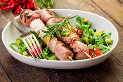 Meat skewers on wooden table Stock Photos
