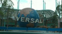 Spinning globe at the main entrance of Universal Studios in Singapore - stock footage