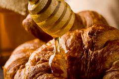 croissants with honey - stock photo