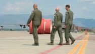 Airmen walking across airfield (HD) c Stock Footage