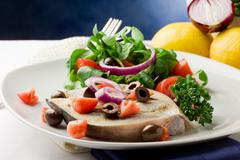 Stock Photo of grilled swordfish with mixed salad