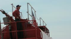Man on fire engine watching for planes (HD) c Stock Footage