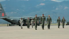 US airmen walking away from US aircraft c130 (HD) c Stock Footage