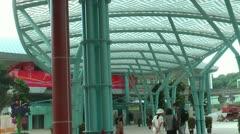 Monorail train departing station at Sentosa Island, Singapore Stock Footage