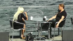 Ladies having cafe on a terrace bar Stock Footage