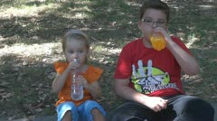 Kids tolk,laugh and drink water,juice. - stock footage