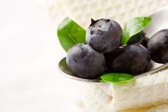 Blueberries on spoon Stock Photos