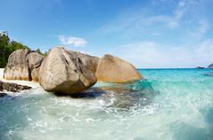boulders and ocean - stock photo
