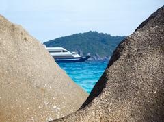 Boulders ship and ocean Stock Photos