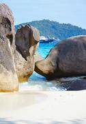 boulders ship and ocean - stock photo