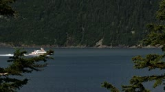 Powerful Fast Tour Boat Heading Out Past Trees Stock Footage