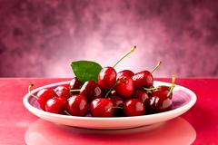 Plate with cherries Stock Photos