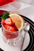 strawberries with lemon - stock photo