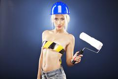 Sexy topless model holding a roller brush. Stock Photos