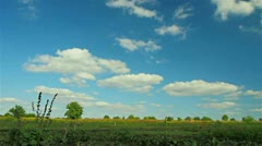 Countryside sunny timelapse with beautiful white clouds - stock footage