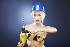 Model with power drill and helmet - stock photo