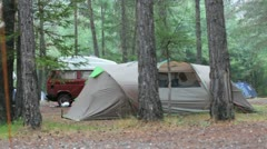 Brwon tent and car in the rain on a rainy day on a campsite Stock Footage