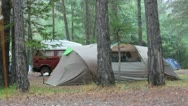 Stock Video Footage of brwon tent and car in the rain on a rainy day on a campsite