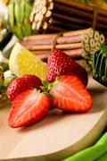 strawberry dessert on cutting board - stock photo