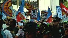 Large group protestors in charlotte democratic national convention 2012 zoom out Stock Footage