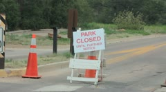 Road barriers blocking road to park due to fire hazard (HD) c Stock Footage