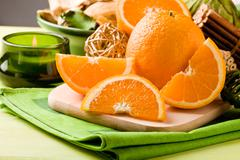 orange dessert on cutting board - stock photo