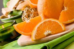Orange dessert on cutting board Stock Photos